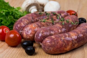 Raw sausages on a cutting board