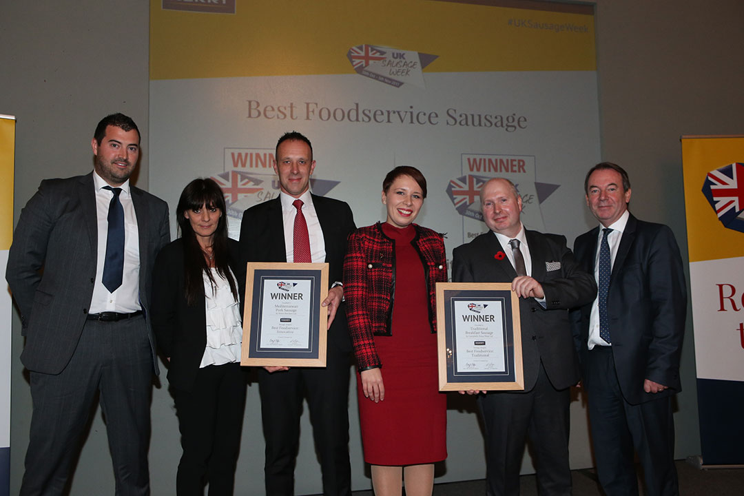 Best Foodservice Sausage<br>L-R: Award partner Stephen Jameson of Kerry, Innovative winners Helen Squires and John Pilcher, Traditional winners Kristina Jonusaite and George Randall, and presenter Eric Knowles.