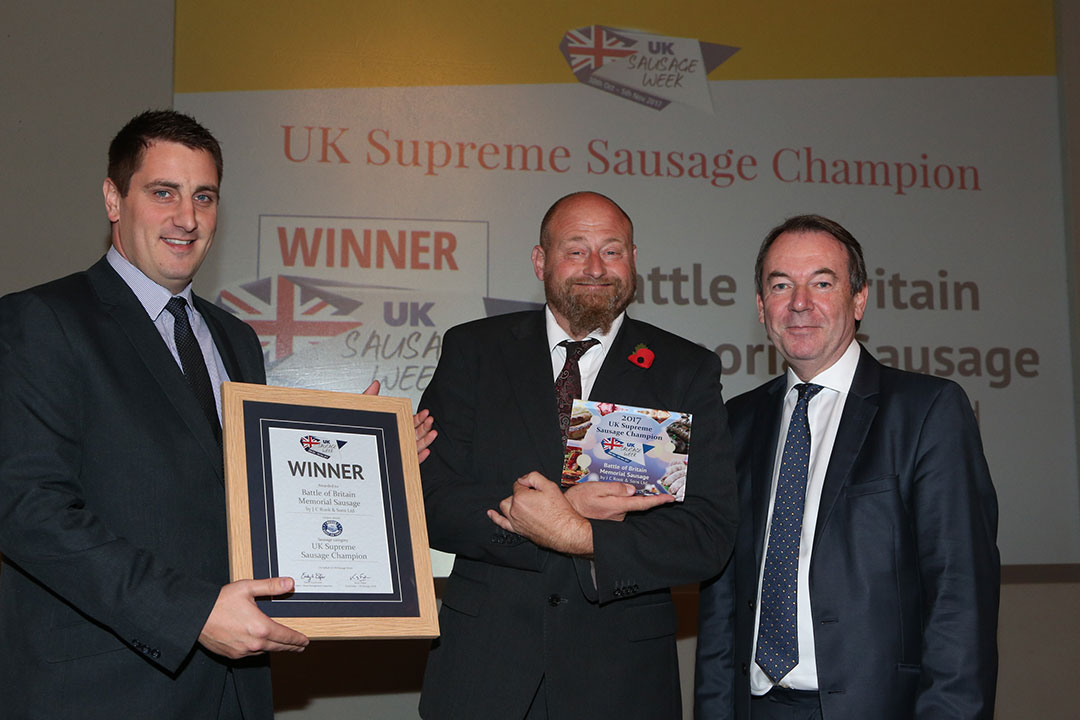 UK Supreme Sausage Champion<br>L-R: Award partner Kenny Wells of Reiser, UK Supreme Sausage Champion Andrew Rook and presenter Eric Knowles.