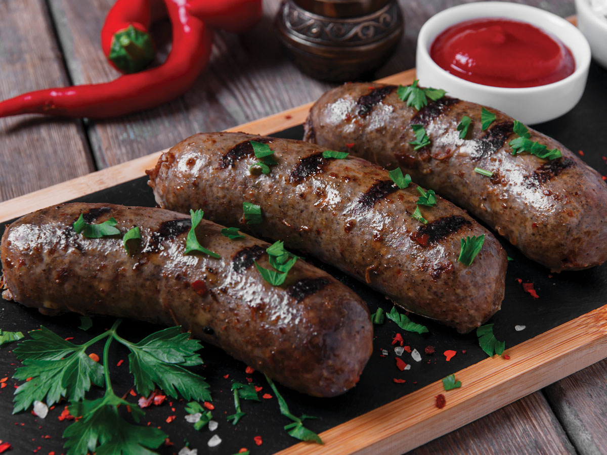 Cooked sausage with tomato ketchup image