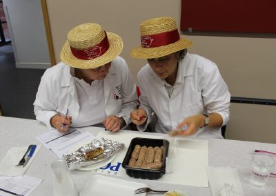 Two members of Ladies in Pigs putting bangers to the test.