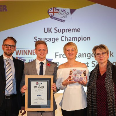 UK Supreme Sausage Champion L-R: Award partner Richard Watson of Reiser UK Ltd, winners George Parker and Hannah Parker of Frank Parker Butchers, and Sophie Grigson.